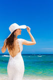 Beautiful brunette bride in white wedding dress and straw hat ha Royalty Free Stock Photography