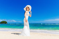 Beautiful brunette bride in white wedding dress and straw hat  Stock Photo