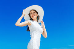 Beautiful brunette bride in white wedding dress and straw hat  Royalty Free Stock Photography