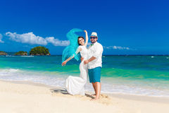 Beautiful brunette bride in white wedding dress with turquoise v Stock Photo