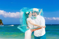 Beautiful brunette bride in white wedding dress with turquoise v Stock Image