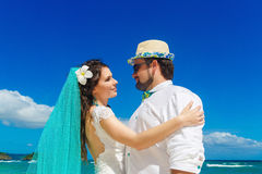 Beautiful brunette bride in white wedding dress with turquoise v Royalty Free Stock Images