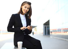 Beautiful brunette business woman working on a tablet Royalty Free Stock Photography