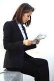 Beautiful brunette business woman working on a tablet Stock Photo