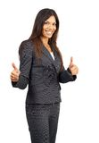 Beautiful brunette businesswoman giving thumbs up Royalty Free Stock Photo