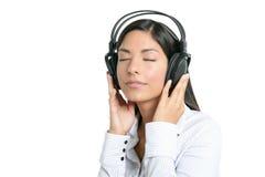 Beautiful brunette businesswoman hearing music Stock Photos