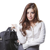 Beautiful brunette businesswoman holding handbag Royalty Free Stock Photography