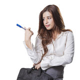 Beautiful brunette businesswoman holding handbag Royalty Free Stock Image