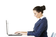 Beautiful brunette businesswoman working on laptop Royalty Free Stock Photography