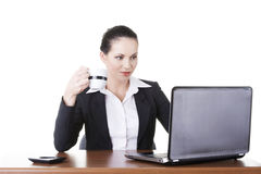 Beautiful brunette businesswoman working on laptop Royalty Free Stock Images
