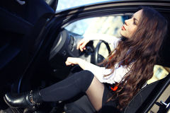Beautiful brunette in a car Stock Image
