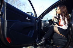 Beautiful  brunette in a car Royalty Free Stock Photo