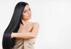 Beautiful brunette caring about her strong healthy bright hair, Stock Photos
