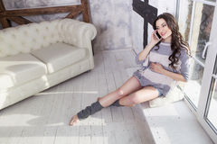 Beautiful brunette caucasian fit pregnant woman in casual outfit Royalty Free Stock Images