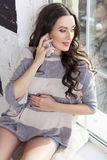 Beautiful brunette caucasian fit pregnant woman in casual outfit Royalty Free Stock Photo