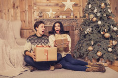 Beautiful brunette caucasian romantic loving couple in cozy warm Stock Photo