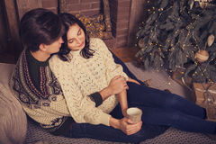 Beautiful brunette caucasian romantic loving couple in cozy warm Royalty Free Stock Images