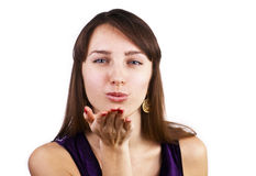 Beautiful brunette caucasian woman blowing kiss Royalty Free Stock Photos