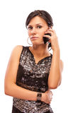 Beautiful brunette with cellphone Royalty Free Stock Photography