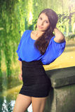 Beautiful brunette at the chateau lake Royalty Free Stock Photos