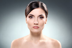 Beautiful brunette with clean face Stock Images