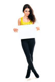 Beautiful brunette with a clean sheet of paper Stock Image