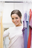 Beautiful Brunette in Closet Stock Images