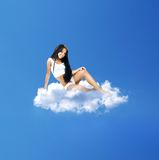 Beautiful brunette on a cloud Royalty Free Stock Images