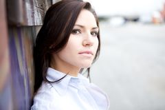 Beautiful Brunette in a collared shirt Stock Images