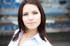 Beautiful Brunette in a collared shirt Royalty Free Stock Images