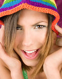 Beautiful brunette with color hat Royalty Free Stock Images