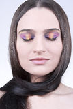 Beautiful brunette with colorful makeup. Image of a beautiful brunette with colorful makeup Royalty Free Stock Photography