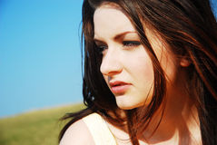 Beautiful brunette contemplating Royalty Free Stock Photo