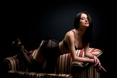 Beautiful brunette on the couch Royalty Free Stock Image