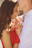 Beautiful brunette couple in love hugging on a date in the park. Royalty Free Stock Photography