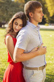 Beautiful brunette couple in love hugging on a date in the park. Stock Photography