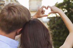 Beautiful brunette couple in love kissing on a date in the park, Royalty Free Stock Photos