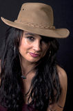 Beautiful brunette with cowboy hat. With black background Stock Images