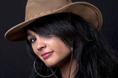 Beautiful brunette with cowboy hat. With black background Royalty Free Stock Photo