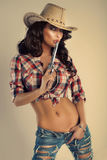 Beautiful brunette cowgirl. Royalty Free Stock Photos