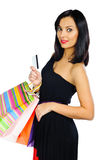 Beautiful brunette with credit card and shopping bags isolated o Stock Images