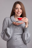 Beautiful brunette with cup of coffee Royalty Free Stock Photo
