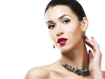 Beautiful brunette with dark makeup wearing blue jewellery Royalty Free Stock Image