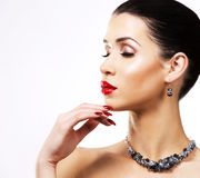 Beautiful brunette with dark makeup wearing blue jewellery Royalty Free Stock Photography