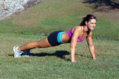 Beautiful Brunette Does Pushups Outdoors (3) Stock Images