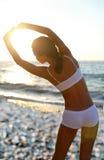 Beautiful brunette doing physical exercises stock photos
