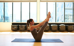 Beautiful brunette is doing pilates Royalty Free Stock Photos