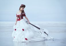 Beautiful brunette in a dress royalty free stock image