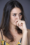 Beautiful brunette in dress making hand gestures Royalty Free Stock Photos