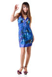 Beautiful brunette in a dress showing ok gesture Royalty Free Stock Photography